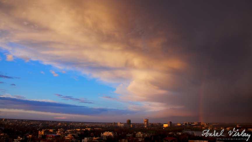 Good bye blue sky - Photograph of rainbow over the Bucharest Romania