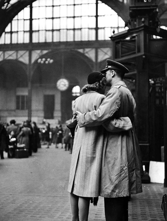 Soldier embracing his girlfriend while saying goodbye in Pennsylvania Station before returning to duty after a brief furlough 1944