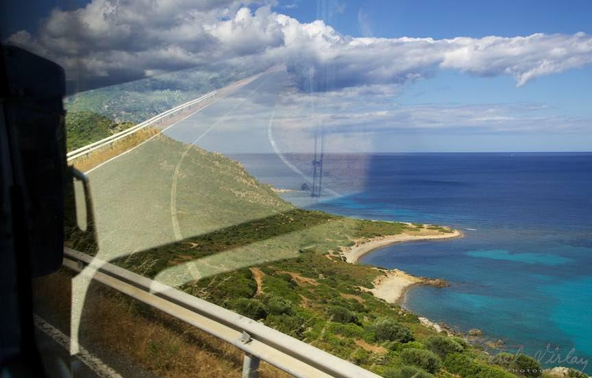 Workshop Fotografie Sardinia Italia - Foto_Aurel_Virlan Road to Heaven! Colaj fotografic prin suprapunearea reflexului in geamul autocarului.